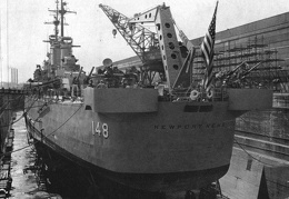 USS Newport News (CA-148) in drydock c1955